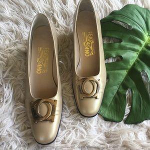 Ferragamo gold metal toe logo block heel pumps